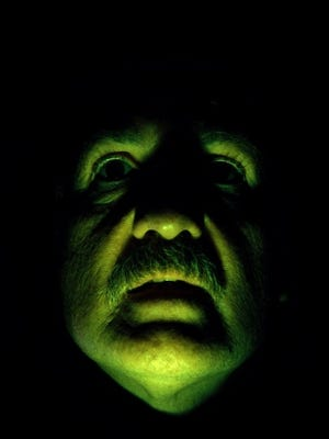 Man's scary green face