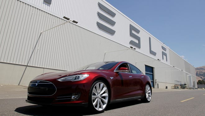 FILE - This June 22, 2012 file photo shows a Tesla Model S outside the Tesla factory in Fremont, Calif. Tesla Motors Inc. on Wednesday, July 25, 2012 said that its second-quarter net loss nearly doubled as it invested heavily to launch its second vehicle, the Model S. (AP Photo/Paul Sakuma, File)