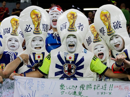 Japanese supporters react before the start of  the group C World Cup soccer match between Ivory Coast and Japan at the Arena Pernambuco in Recife, Brazil, Saturday, June 14, 2014.