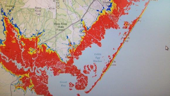 The red (in my photo of the map) shows storm surge