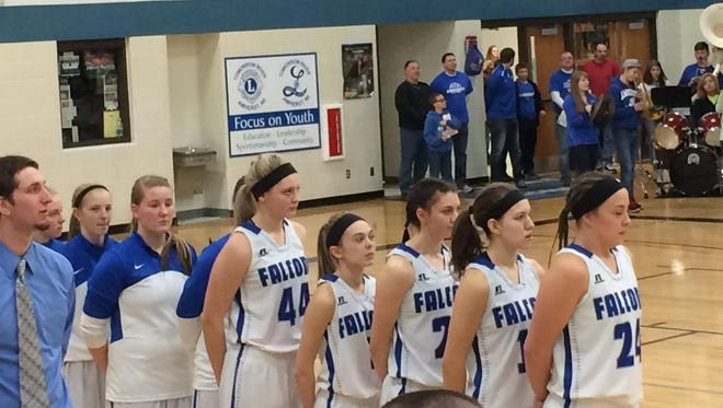 Members of the Amherst girls basketball team line up for the national anthem prior to the start of the WIAA Division 4 regional semifinal contest with Gibraltar on Friday night.
