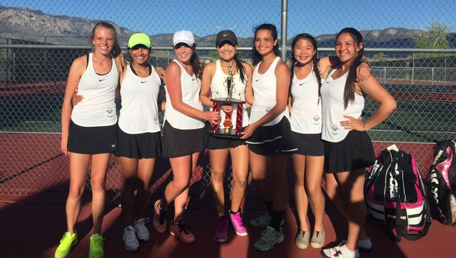 Farmington tennis players Elise Ballard (far left), Monica Briones, Hailie Nygren, Riley Coleman, Katherine Fisher, Emily Nguyen and Michelle McGrath pose with their second-place trophy after the Albuquerque Academy Invite on Saturday in Albuquerque.