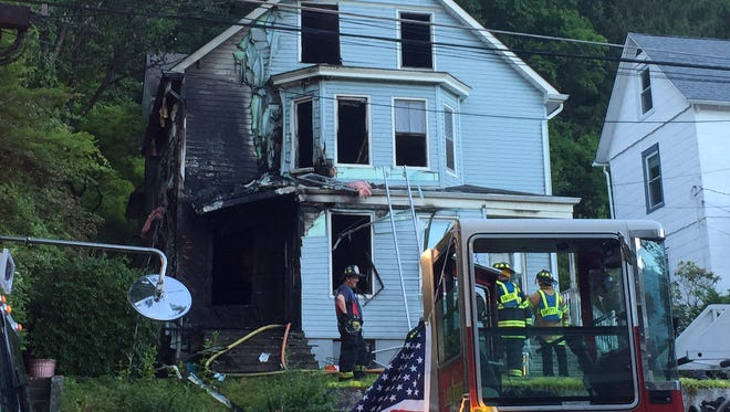 An early-morning fire destroyed a two-family home on Chestnut Street in Morristown on Friday, June 10, 2016.