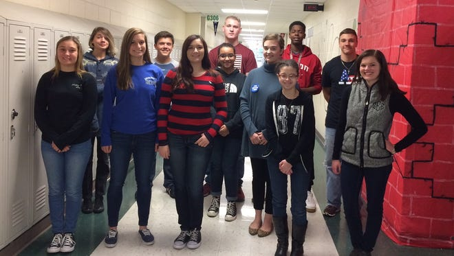Henderson County October students of the month are, front row from left: Emma Phelps, Maggie Hendricks, Olivia Sadler, Anayjah Courtney, Mary Jane Mayo, Whitney Lane and Sierra Evans. Back row: Damion Kladis, Trace Denton, Bryce Galloway, James Savage and Will Steiner.