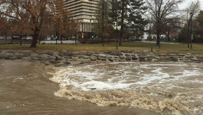 The Truckee River in downtown Reno is swollen after a storm hit the area Saturday, Dec. 10, 2016.
