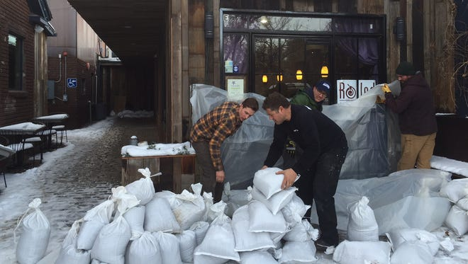 Local businesses prepare for potential flooding on Saturday, Jan. 7, 2017.
