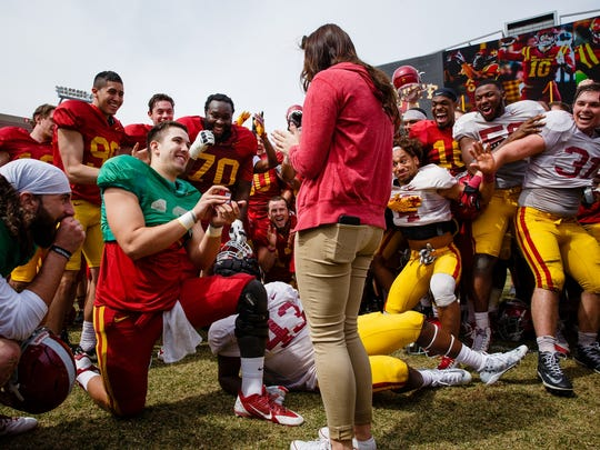 Iowa State redshirt junior quarterback Kyle Starcevich (16) proposes to his girlfriend of five years, Tori Monroe, after the ISU spring game on Saturday, April 8, 2017, in Ames.