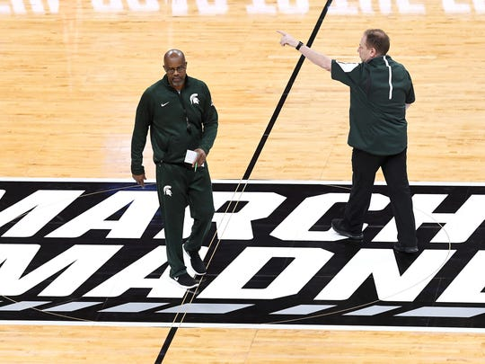 Michigan State's assistant coach Mike Garland, left,