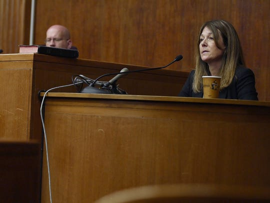 Jennifer Gonzales on the witness stand in Superior Court during a hearing on a motion to take away Henry Farrell's guns in Hackensack on Thursday, April 12, 2018. Her son, Jack Gonzales Farrell, 17, shot himself with a gun belonging to her ex-husband, Henry Farrell, on Nov. 27, 2016. He died two days later