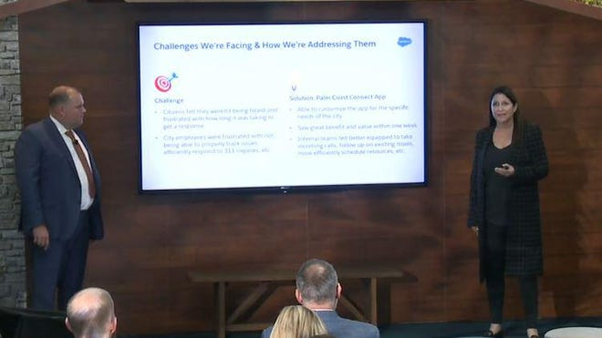 Palm Coast Mayor Milissa Holland, right, and Matt Morton, the city's chief of staff, give a Nov. 20 presentation during a tech conference they both attended in San Francisco.