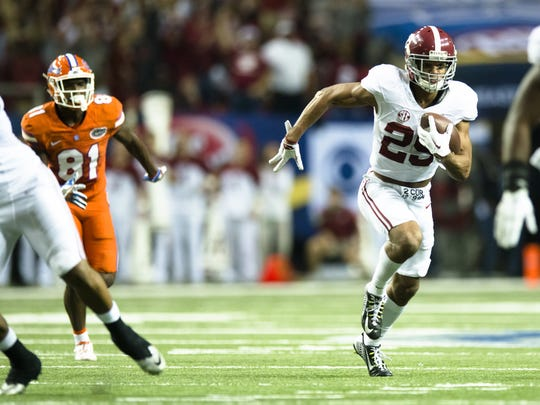 Alabama defensive back Minkah Fitzpatrick (29) intercepts a pass during the first half of the SEC Championship football game between Alabama and Florida on Saturday, Dec. 3, 2016, in Atlanta, Ga.