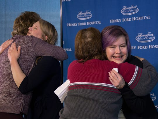 Carol King, 64, of Portage, Mich., left, hugs Kara Dander, 33, of Bemidji, Minn., who donated her kidney to her daughter Emily King, 39, of Kalamazoo who is being hugged by Dander's mother, Holly Proctor, 61, (red sweater), as kidney donors and their recipients gather at Henry Ford Hospital in Detroit on Wednesday Dec. 27, 2017.