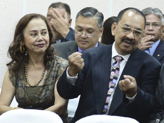 In this May 2013 file photo, Dennis Rodriguez, Sr., right, and his wife, Asuncion, are photographed during the State of the Judiciary address at the Guam Legislature.