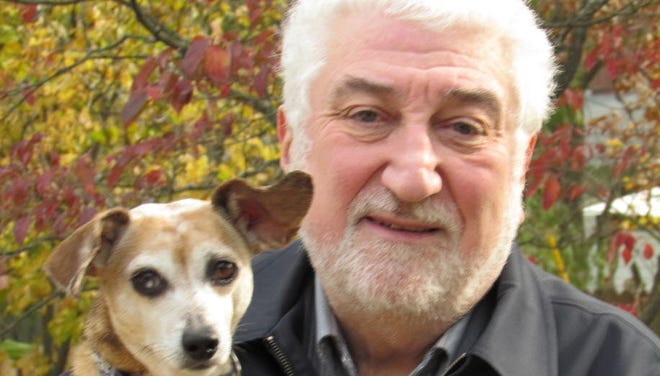Alan Beck enjoys time with his dog, Lili. A Purdue University expert, Beck says animals can improve people's physical and emotional health.