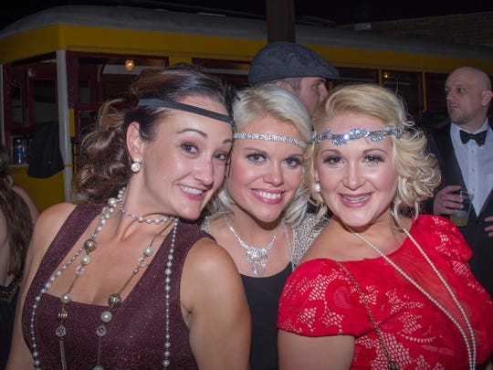 Kristin Vaughn, Ashley Saba and Heather Kilpatrick pose during last year's Gatsby Girls Speakeasy Ball. The Krewe of the Gatsby Girls will hold its fifth annual Speakeasy Ball on Saturday.