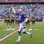 Bills punter Brian Moorman (8) is welcomed back by fans before the game against the Bengals this season.