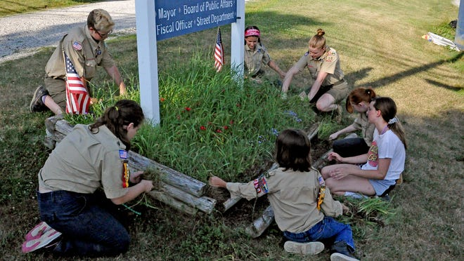 Boy Scout Troop 338, an all-girl troop, met in Holmesville to clear weeds from around the Village Hall sign as a service project to the village. Front left Jenna Brumme, (clockwise) Michelle Hickling, Mya Marcurella, Brenna Barbey, Katie Bates, Trisha Barkman and Cheyenne Strait.