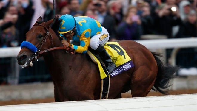 Jockey Victor Espinoza guides American Pharoah, to victory in the Breeders' Cup Classic. Oct. 31, 2015.