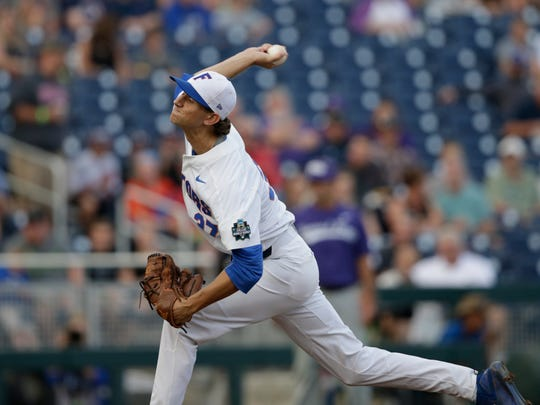 Florida's Jackson Kowar pitches during the first inning of an NCAA College World Series last season.