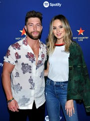 Chris Lane and Lauren Bushnell pose backstage at Spotify's Hot Country Live Presents Florida Georgia Line at The Wiltern in Los Angeles.