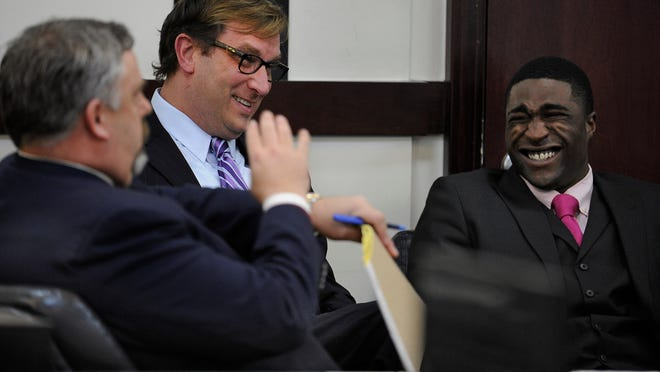 Cory Batey, right, and attorneys Fletcher Long and Worrick Robinson seemed to be in a light-hearted mood during the lunch break before the jury deliberated during the Vanderbilt rape trial on Tuesday, Jan. 27, 2015, in Nashville.