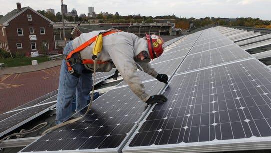 Mike Dertinger of Invictus Electrical installs solar