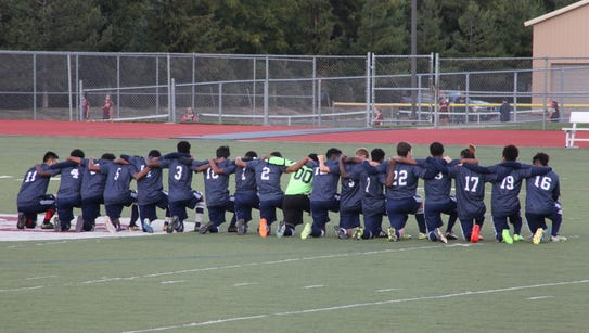 All 18 players for the World of Inquiry boys soccer