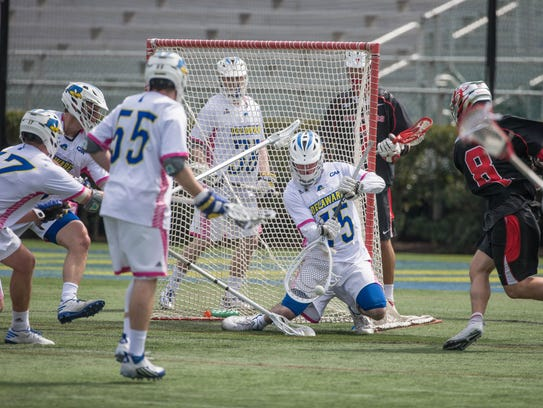 Delaware goalie Matt DeLuca makes one of his 19 saves against Rutgers last year. A sophomore, DeLuca is in his second season as the starter and is not related to Delaware's coach.