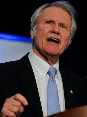 Oregon Gov. John Kitzhaber speaks to supporters at the Democratic election night party in Portland Ore., Tuesday, Nov., 4, 2014.