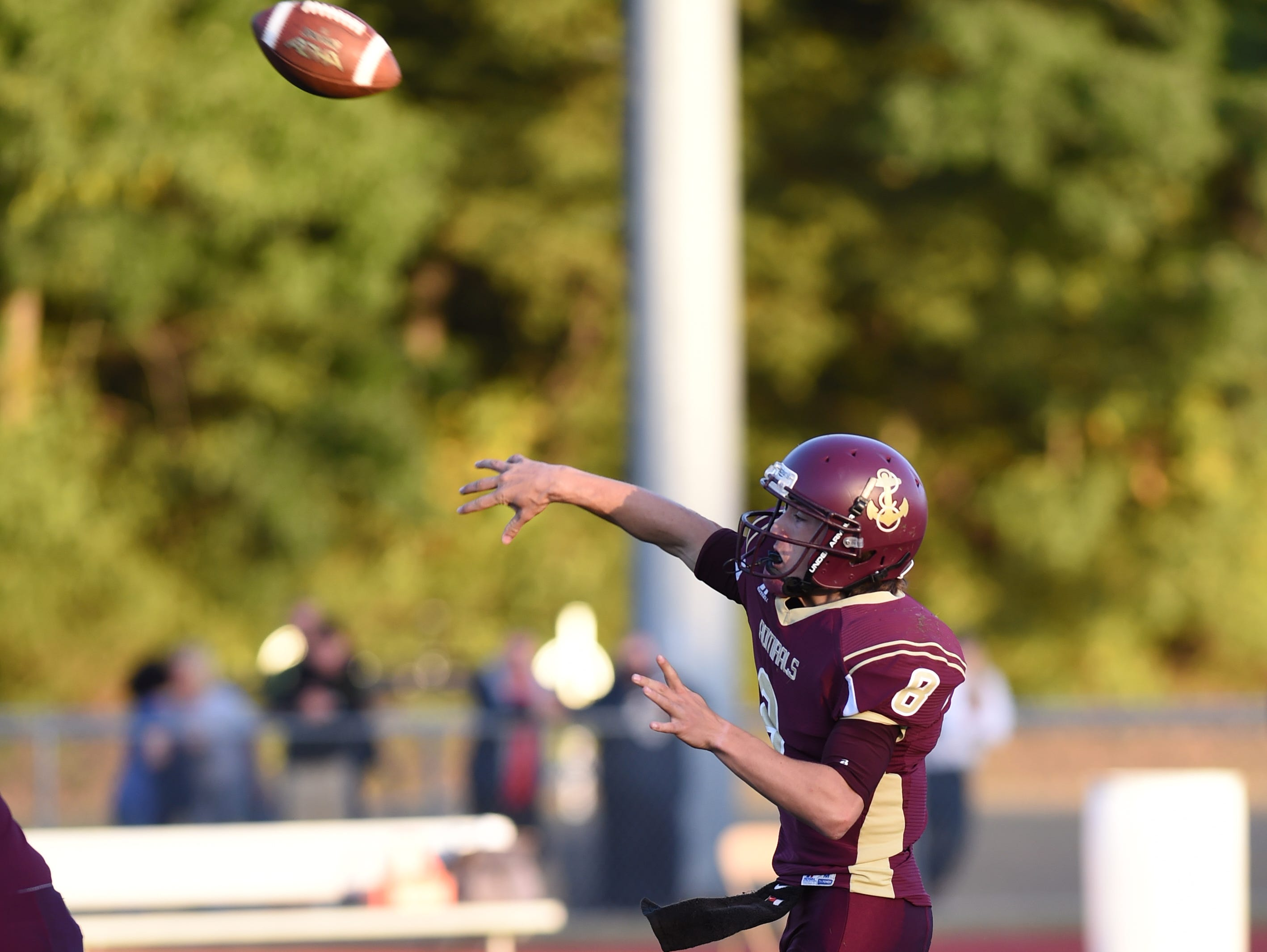 Arlington's Austin Heck passes the ball during Friday's home game versus John Jay.