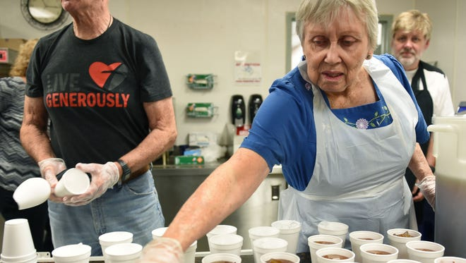 Jean Norwillo, right, and her husband, Len, prepare tea while volunteering at KARM serving lunch Tuesday, Aug. 15, 2017. KARM is one of the nonprofits with projects for the Give A Day volunteer program in September that is endorsed by both mayors.