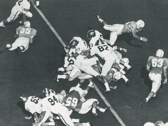 Tennessee's Mike Jones, beneath pile, scores the first touchdown on Tartan Turf at Neyland Stadium versus Georgia in 1968.