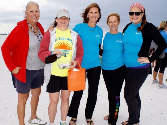 Getting ready for the beach yoga fundraiser are Elaine Lancaster, member of beach advisory committee; Samantha Malloy, city of Marco events coordinator, and yoga instructors Laurie Kasperbauer, Meagan Mikulsky and Debbie Amicucci.