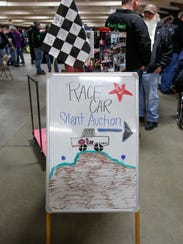 A sign for the silent auction at the eighth annual
