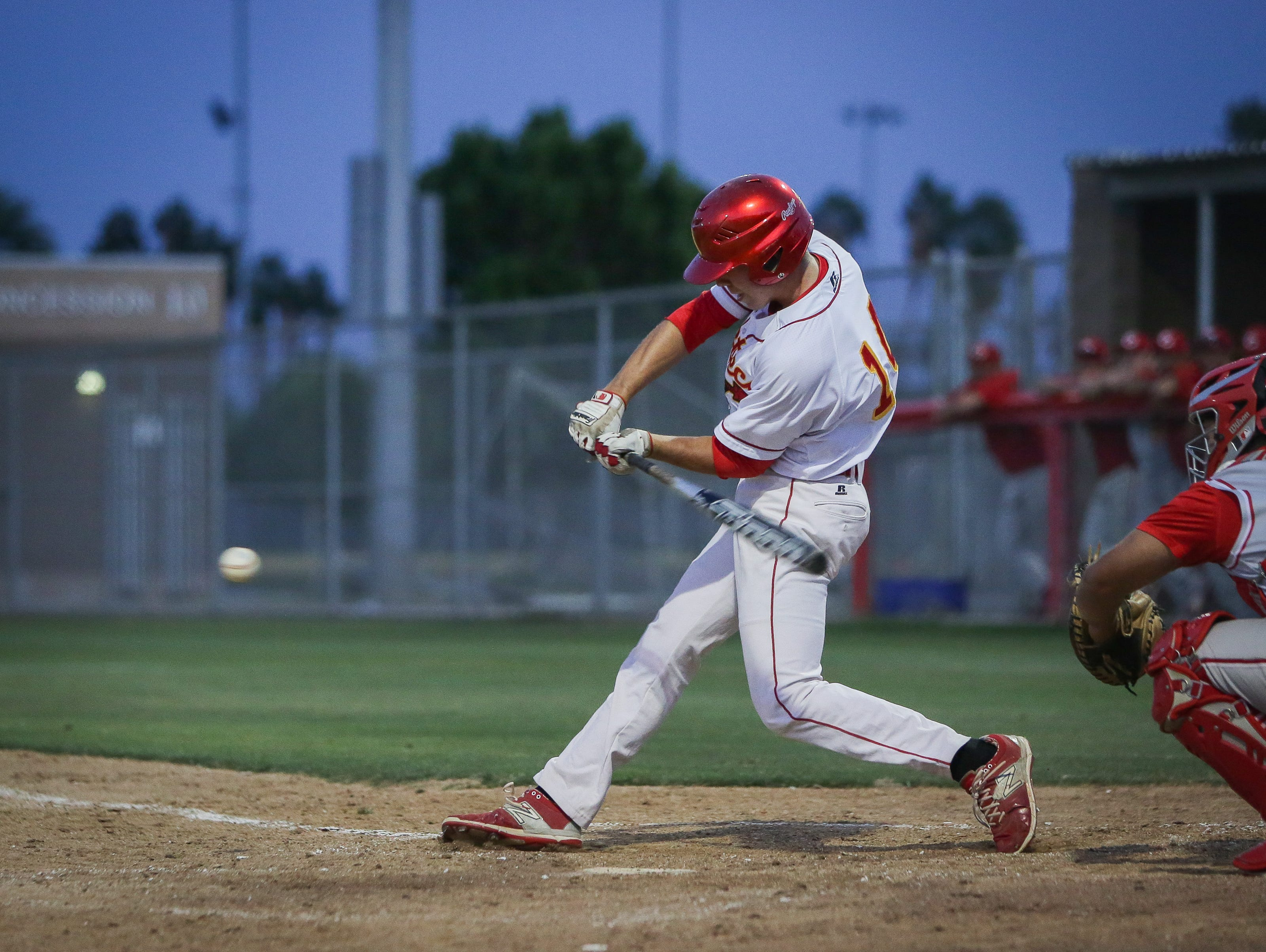 Max Puls hitting the ball in Palm Desert's 5-0 loss to Corona.