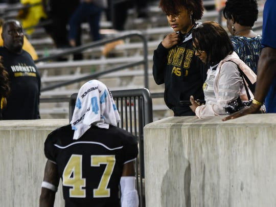 Kurron Ramsey with family after the the game.  Alabama State lost its 4th game of the season against PVAMU, Saturday Sept. 23, 2017.