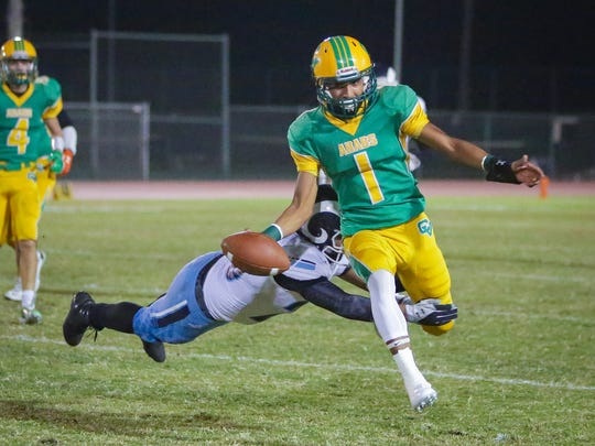 Armando Deniz almost sacked. The Coachella Valley varsity football team won Friday's home playoff game against Ramona by a score of 45-7. This is the first home football playoff game for the Arabs since 1988.