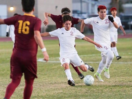 Erick Serrano kicks the ball to his team mate. The