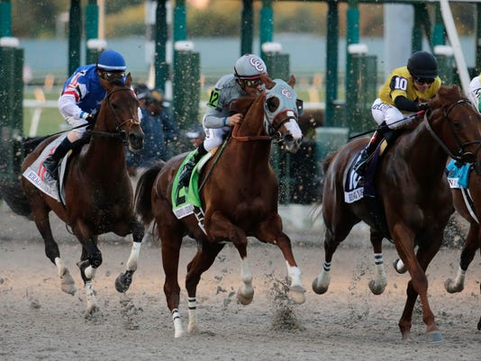 Jockey Victor Espinoza rides California Chrome (12) out of the starting gate in the inaugural running of the $12 million Pegasus World Cup horse race at Gulfstream Park, Saturday, Jan. 28, 2017, in Hallandale Beach, Fla. At left is jockey Edgar Prado riding Eragon (11) and at right jockey Luis Contreras riding Breaking Lucky (10). Arrogate won the race. (AP Photo/Lynne Sladky)