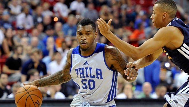Sean Kilpatrick of the Sixers drives the ball against Utah's Dante Exum during an NBA Summer League game Saturday in Las Vegas.