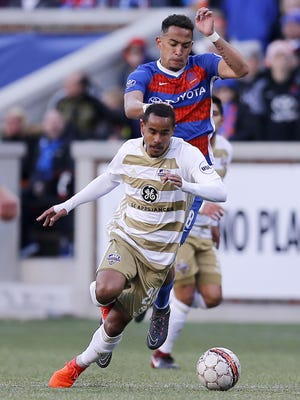 Louisville midfielder George Davis (22) takes the ball down field during the first half of the USL soccer match between FC Cincinnati and Louisville City FC at Nippert Stadium in Cincinnati on Saturday, April 7, 2018. At halftime Louisville led 1-0.