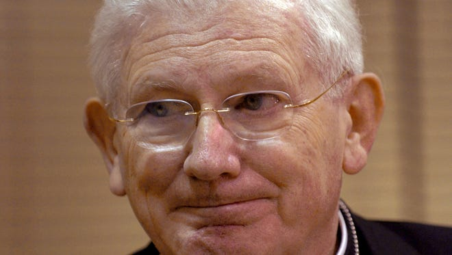 FILE - In this Saturday, April 2, 2005, file photo, Baltimore Cardinal William Keeler speaks to reporters before conducting Mass at The Cathedral of Mary Our Queen, in Baltimore. Keeler, who helped ease tensions between Catholics and Jews, has died. (AP Photo/Gail Burton, File)