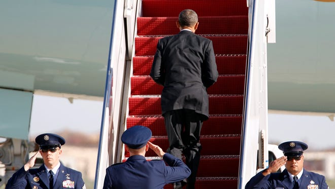 President Obama boards Air Force One