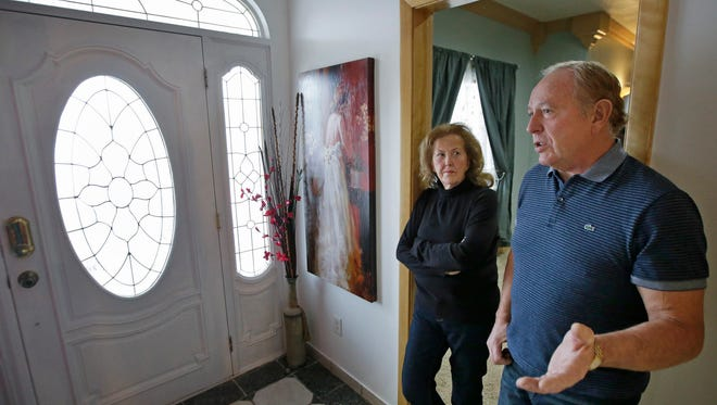 In this Dec. 16, 2014 photo, Ron Rohbock and his wife, Geri, stand in their home in Hildale, Utah. Ron Rohbock, a former member of the Fundamentalist Church of Jesus Christ of Latter-Day Saints, or FLDS, was kicked out in 2002. He is one of more than 40 people called as a witness by the Department of Justice during a January discrimination trial in Phoenix.