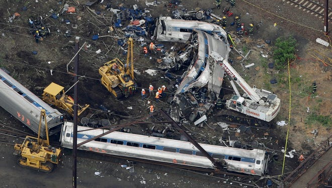 Emergency personnel work at the scene of the deadly May 12 train wreck in Philadelphia.