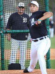 Tigers pitching coach Chris Bosio watches pitcher Alex