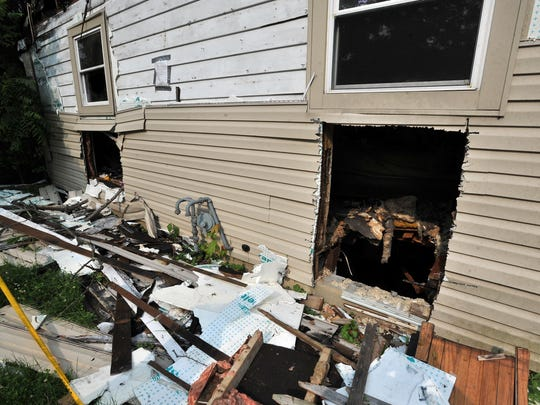 Firefighters cut two holes into the basement of Leisa and John Marcum's home in Canal Winchester. Firefighters were trying to rescue Leisa's son, Josh Coyle, and his girlfriend, Jessica Moore, who were trapped in the basement.