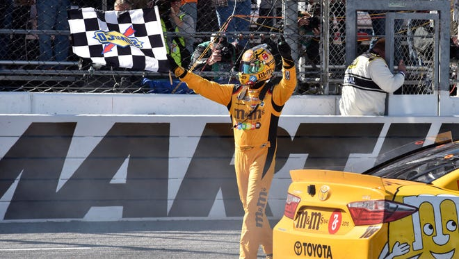 Kyle Busch celebrates after winning the STP 500 at Martinsville Speedway.