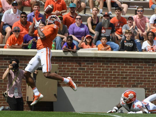 Clemson wide receiver Tee Higgins (5) catches a touchdown pass near Clemson cornerback Mark Fields (2) during the 1st quarter of the spring game in Memorial Stadium in Clemson on Saturday, April 14, 2018.