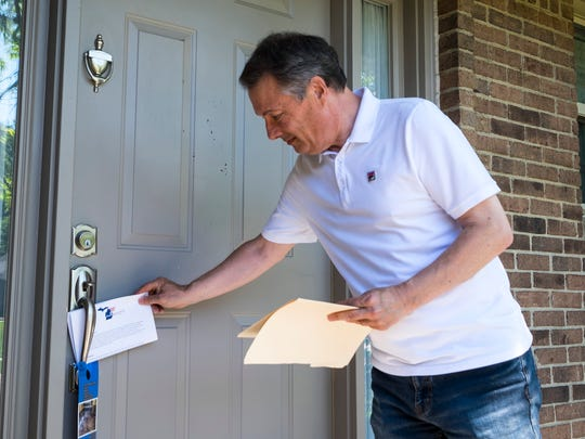 Frank Accavitti slips a copy of his campaign brochure